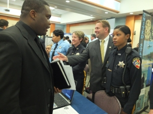 Corrections Officer Kim Martin, Sheriff's officer Edna Morasse, Sheriff Shaun Golden, and Sheriff's Officer Michelle Tucker staff a table at the NOBLE Job Fair at Brookdale Community College on 5/9/14