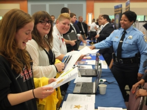 Students from Explorer Post #1 stop at Sheriff's Office table at the NOBLE Job Fair at Brookdale Community College on 5/9/14