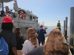 Boson's Mate John Martorelli explaining use of self-righting cutter at Sandy Hook